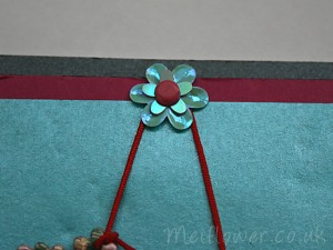 Layered Sequin Flower Attached To Card With A Brad