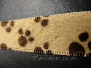 Novelty paw print ribbon for dog lovers