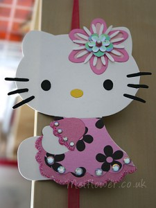 Hello Kitty In Pink Dress With Black Flowers.