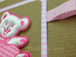 Close up of folded pink embossed baby ribbon
