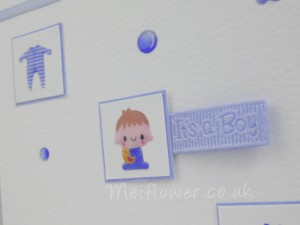 Baby boy patterned ribbon used on a handmade card