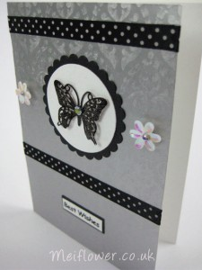Silver decorative filigree metal butterlfly coloured in black