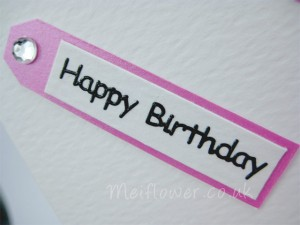 Birthday sentiment mounted in a tag form
