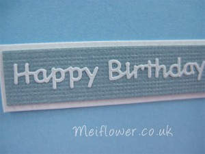 Birthday sentiment peel off mounted onto baby blue bazzil and white card