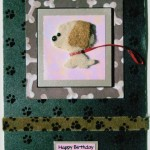 dog card using padded brown dog, red ribbon, paw print ribbon