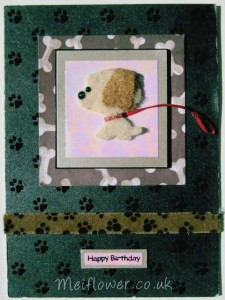 dog card using padded brown dog, red ribbon, paw print ribbon