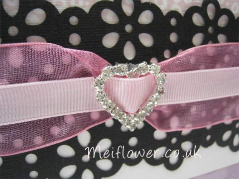 Diamante buckle with organza ribbon and grosgrain through the centre