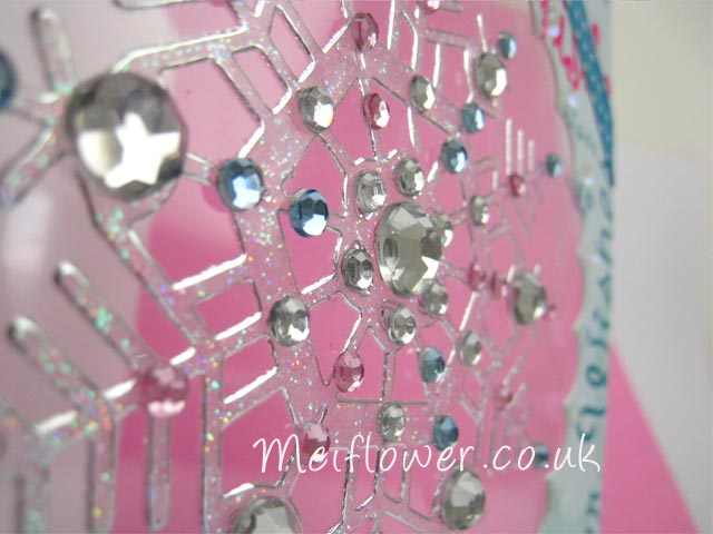 Diamante gems stuck onto peel off snowflake