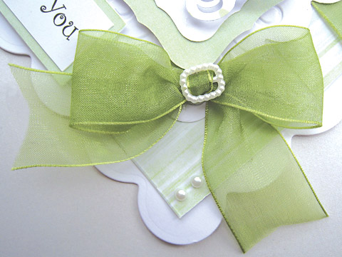 Traceys 'Thank You' card using pearl ribbon buckles